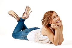 Beautiful young woman lay on the floor Stock Photo