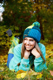 Beautiful young woman laying on the grass Royalty Free Stock Photos