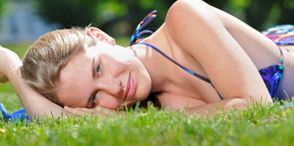 Beautiful young woman laying out - summer royalty free stock images