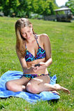 Beautiful young woman laying out - summer Royalty Free Stock Image