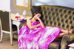 Beautiful young woman laying on the sofa Stock Images