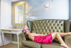 Beautiful young woman  laying on the sofa Royalty Free Stock Photo