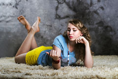 Beautiful Young Woman Laying On White Floor Royalty Free Stock Image