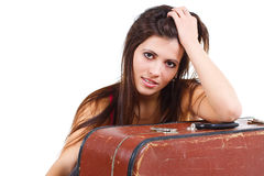 Beautiful young woman leaning on old suitcase Stock Photo