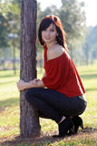 Beautiful Young Woman Leaning on a Tree (4) stock photo