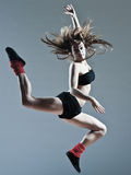 Beautiful young woman leap jump. Beautiful young caucasian woman girl dancer ballet breakdance leap jump on studio  background Stock Photography