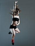 Beautiful young woman leap jump Stock Photography