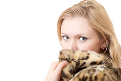 Beautiful young woman in leopard fur coat. Concept winter fashion & makeup Stock Photography