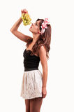 Beautiful young woman let her head back to eating a bunch of gra Royalty Free Stock Photo