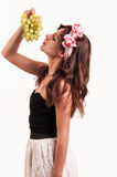Beautiful young woman let her head back to eating a bunch of gra Stock Photos