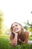 Beautiful young woman lie on grass Stock Images