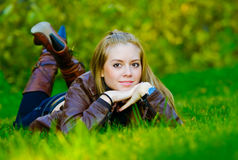 Beautiful young woman lies on grass Stock Photos
