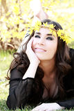 Beautiful young woman lies on green grass Royalty Free Stock Photography