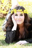 Beautiful young woman lies on green grass Stock Photo