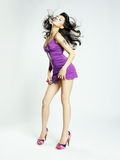 Beautiful young woman in lilac dress Stock Photo