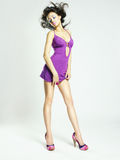Beautiful young woman in lilac dress Stock Photography