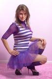 Beautiful young woman in lilac dress Stock Photos
