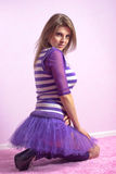 Beautiful young woman in lilac dress Stock Images
