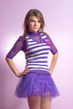 Beautiful young woman in lilac dress Royalty Free Stock Photos