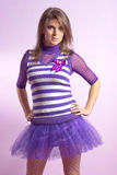 Beautiful young woman in lilac dress Stock Image
