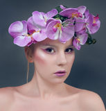 Beautiful young woman with lilac flowers in hair Stock Photos