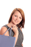 Beautiful young woman with lilac shopping bag Stock Photo