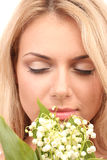 Beautiful young woman with lilies Royalty Free Stock Photo