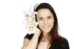Beautiful young woman with lily flower Royalty Free Stock Photo