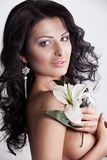 Beautiful young woman with lily flower. Stock Images