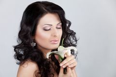 Beautiful young woman with lily flower. Stock Image