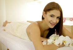 Beautiful young woman with lily flower Stock Photography
