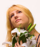 Beautiful young woman with lily flower Royalty Free Stock Photos