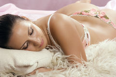 Beautiful young woman in lingerie asleep Royalty Free Stock Photo