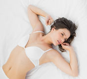 Beautiful young woman in lingerie on bed Royalty Free Stock Photos