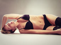 Beautiful young woman in lingerie on the floor Royalty Free Stock Photography