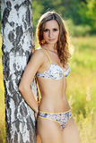 Beautiful young woman in lingerie outdoors Royalty Free Stock Photography