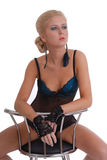 Beautiful young woman in lingerie with stool Stock Photo