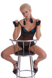 Beautiful young woman in lingerie with stool Royalty Free Stock Photo