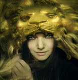 Beautiful young woman with lion mask. Artistic portrait of a beautiful young woman with a mask of the face of a majestic golden lion stock illustration