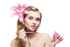 Beautiful young woman with lip gloss Royalty Free Stock Photography