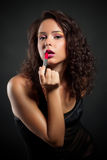 Beautiful young woman with lipstick Stock Image