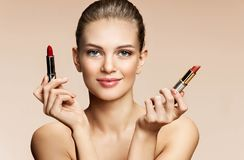 Beautiful young woman with lipstick. Stock Images