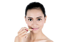 Beautiful young woman with lipstick Royalty Free Stock Photography