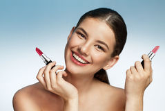 Beautiful young woman with lipstick Royalty Free Stock Images