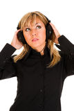 Beautiful young woman listening music. In headphones Royalty Free Stock Photo
