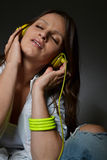 Beautiful young woman listening music Stock Photography