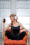Beautiful young woman listening to the music Royalty Free Stock Photos