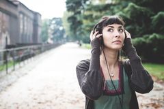 Beautiful young woman listening to music Royalty Free Stock Images
