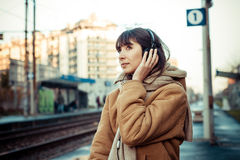Beautiful young woman listening to music headphones Stock Photo