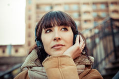 Beautiful young woman listening to music headphones Royalty Free Stock Photography